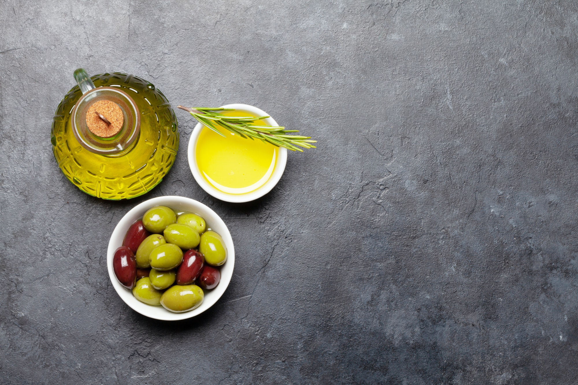 Ripe olives and olive oil